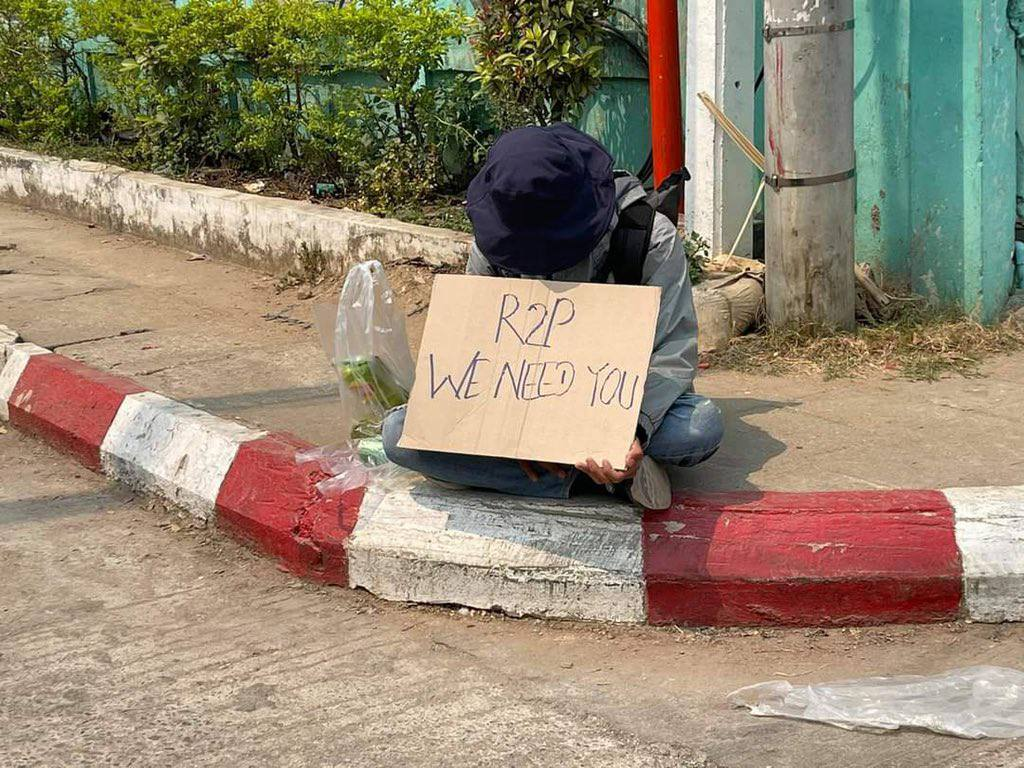 "A young boy held a banner that says ""R2P, We Need You"" in front of Tarchileik University, Shan State. We are suffering a lot under the coup. We desparately need help.  R2P FOR MYANMAR #WhatsHappeningInMyanmar #Mar7Coup https://t.co/A92Y459GbV"