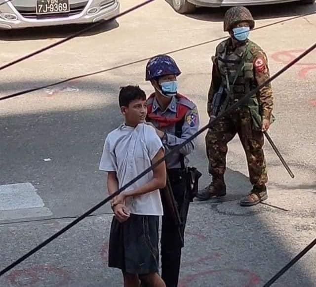 #PHOTO security force arresting an underage kid while raiding Orient teashop in #Yangon. Neighbours said he works at the tea shop. [social media photo]  #WhatsHappeningInMyanmar #BurmaCoup #Mar8Coup