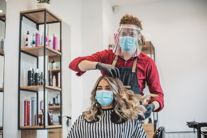 Personal service site settings like salons require the service provider to wear personal protective equipment (PPE) that includes a medical grade mask and eye protection. Check out this factsheet for more information: