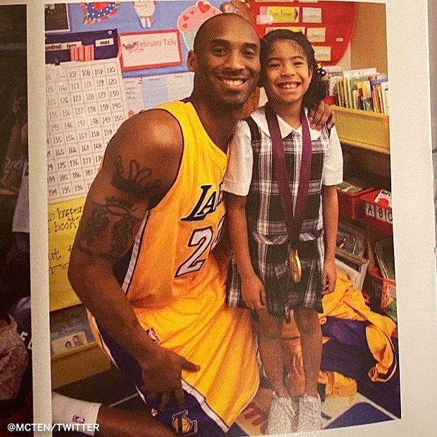 Kobe showed up to Gianna's career day in full uniform and with a gold medal.  This photo was shared in the program given out during the memorial held at Staples Center one year ago today.