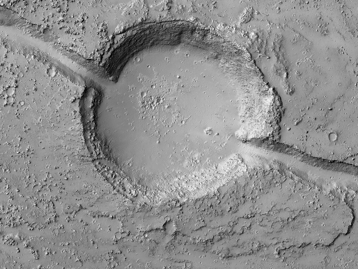 Hi8K: The Bisected Crater This impact crater is cut by a fracture that is part of the Cerberus Fossae. The fracture also cuts young lavas. It is not clear whether the crater or the lavas are older. (Click link for full cutout.) flic.kr/p/2kEBJdL #Mars #science