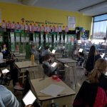 Image for the Tweet beginning: 4th graders using iPads for