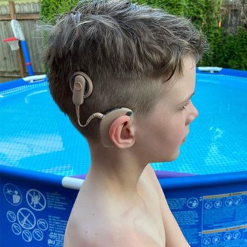 """""""My son has always been uncomfortable with people asking about his implants so kept his hair long. But today he decided on his own to have me cut it. I'm so proud of him for being brave and deciding to own his difference and show us all."""" - Mychal  #NationalCochlearImplantDay"""