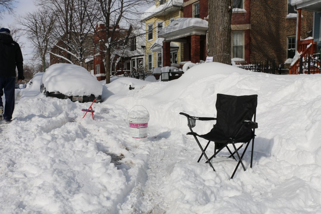 """Get your chairs outta the street! """"Dibs"""" items will be picked up and thrown out by city garbage crews starting Tuesday."""