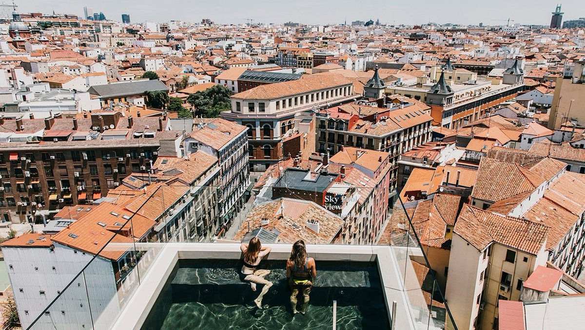 @Swim above the terracotta rooftops of Madrid at this stylish boutique hotel. Would you like to take a dip here? 🏊😎 #spain #design #summer #travel #wanderlust #interiordesign @DearHotelMadrid