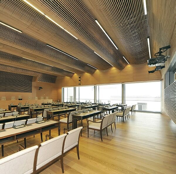 Our  linear wood ceilings are available in solid wood or with a wood veneer finish.  This beautiful wood effect finish is ideal for larger building projects. #ceilings #walls #architecture #interiordesign #design