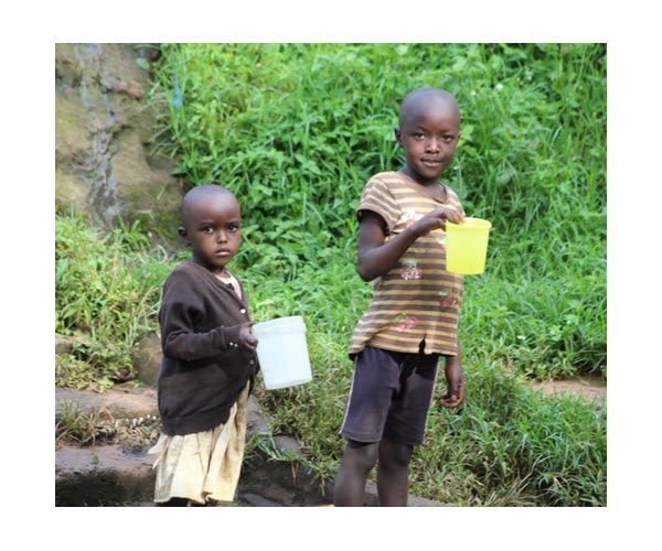 Two young children from the Kenyan village of Nyandoche Ibere. Purified water makes all the difference in the world and something many in America take for granted.  Do you want to help? Even a small donation will make a difference.    #Water #HelpEmmah
