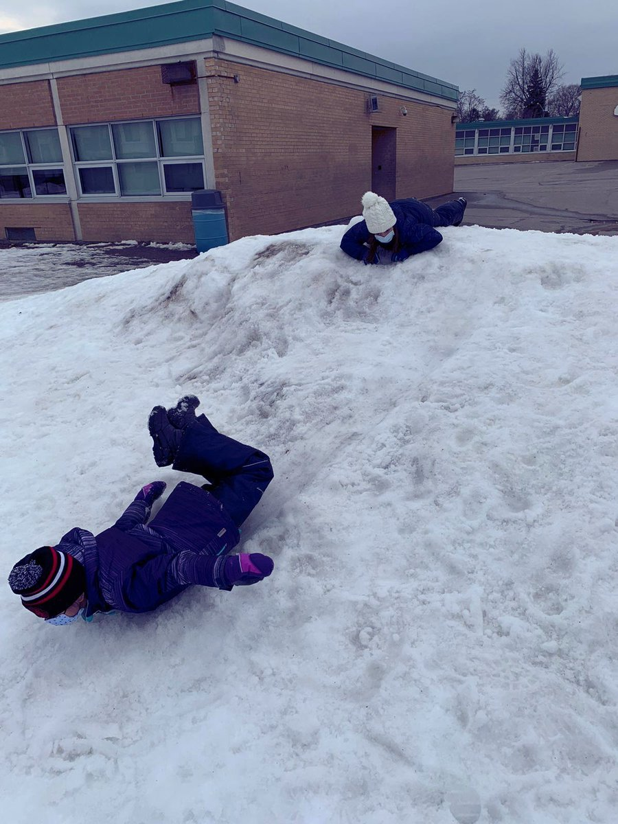 Friday outdoor fun with these school agers from Beverly Acres #childcare #learningthroughplay #learning #howdoeslearninghappen #creativeminds #kcceba #kidsconnection #schoolage #winterfun #snow