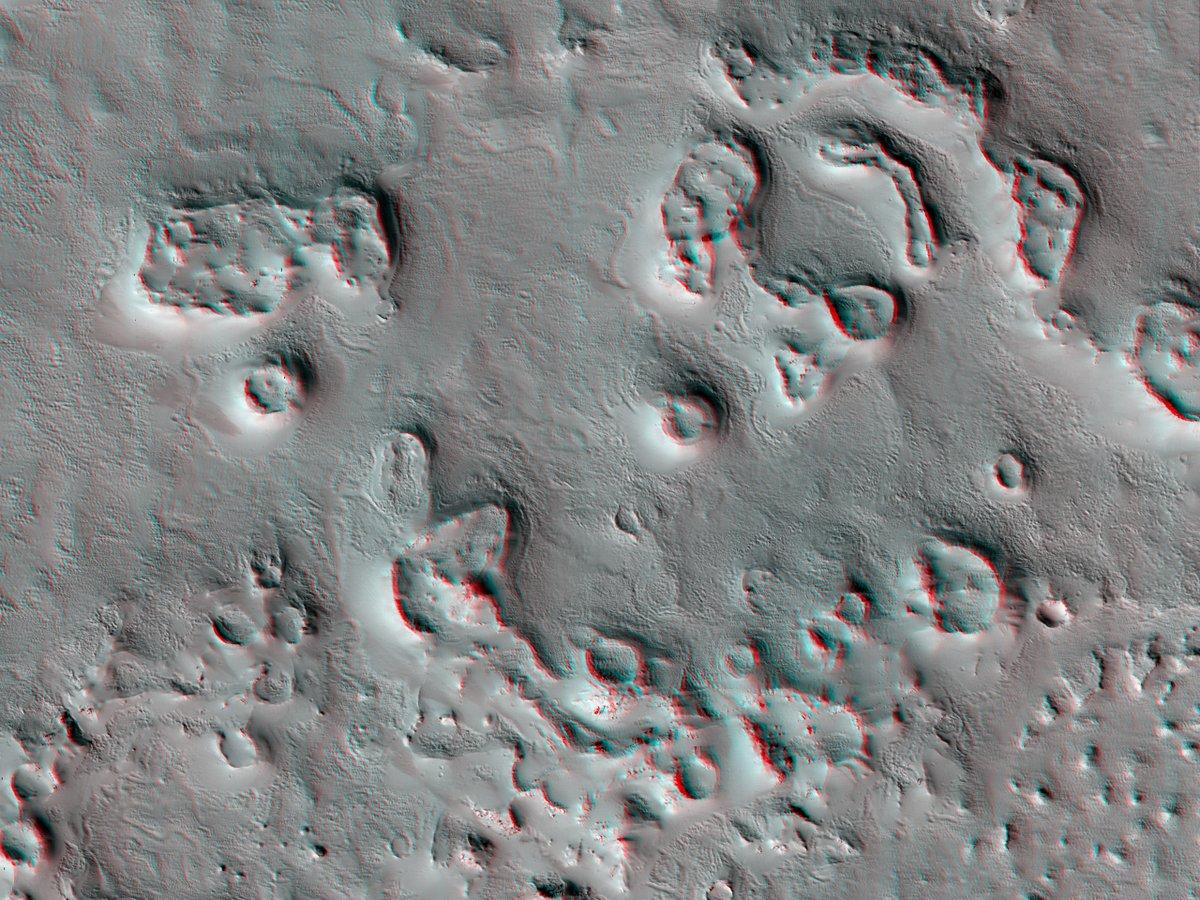 Hi3D: Circular Features North of Olympus Mons The main goals of studying the circular features north of Olympus Mons are to understand the geological origin of their viscous flow materials. bit.ly/hi3d-26-feb-21