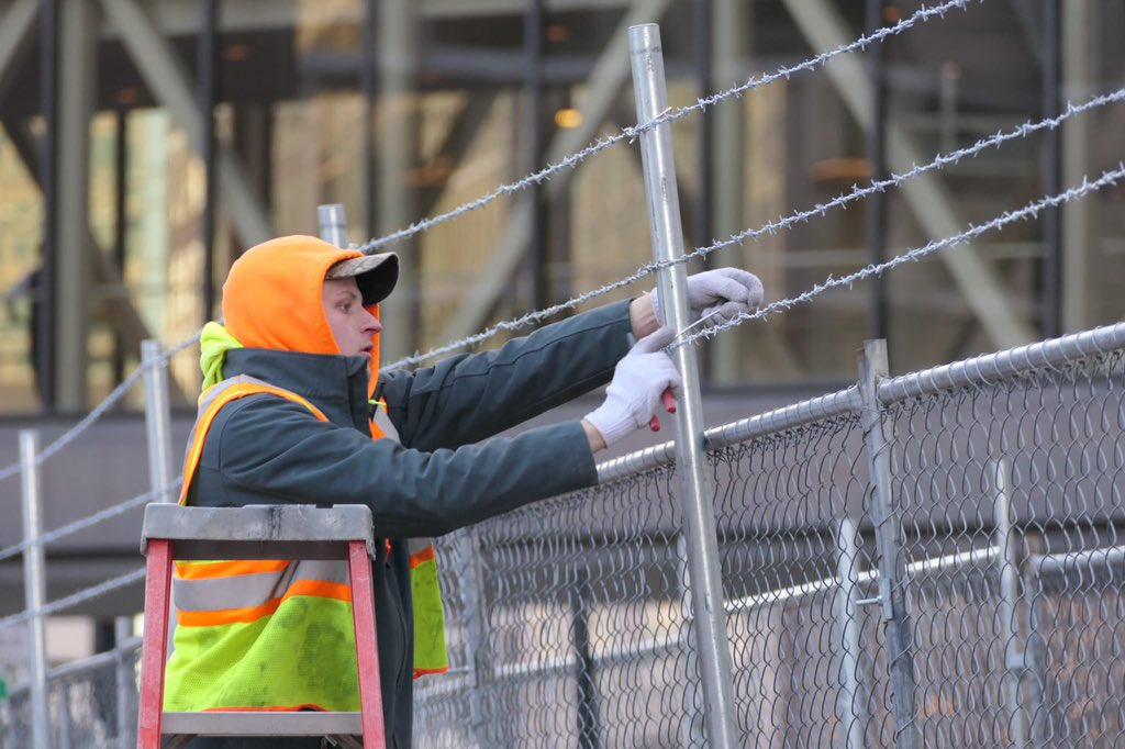 Barbed wire barriers are going up in Minneapolis ahead of the trial for Derek Chauvin, the cop who murdered George Floyd.