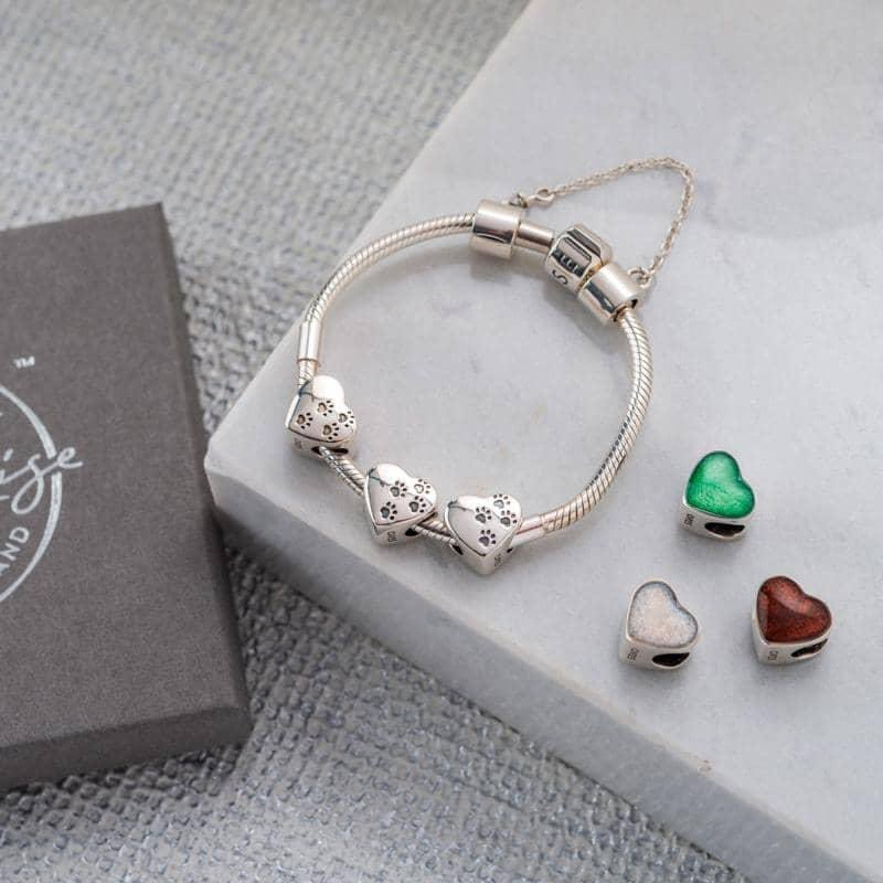Paw prints on your heart forever with the gorgeous pet ashes charm.    #ashes #ashesjewellery #memorialjewellery  #jewellery #smallbusiness