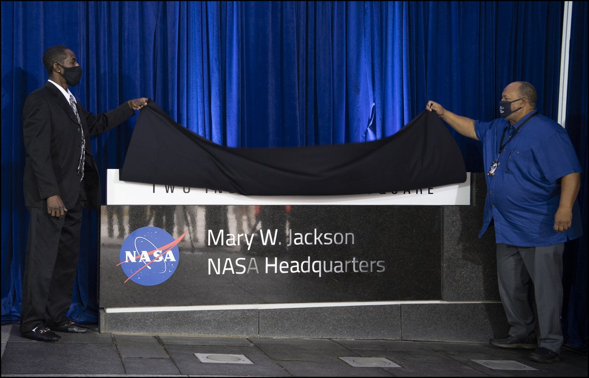 The Mary W. Jackson NASA Headquarters sign is unveiled by her grandson Bryan Jackson, left, and son-in-law Raymond Lewis, right, during the naming ceremony this afternoon. More pictures from the ceremony ➡️ https://t.co/GLb2g5iOkf https://t.co/PXgNfGFP73