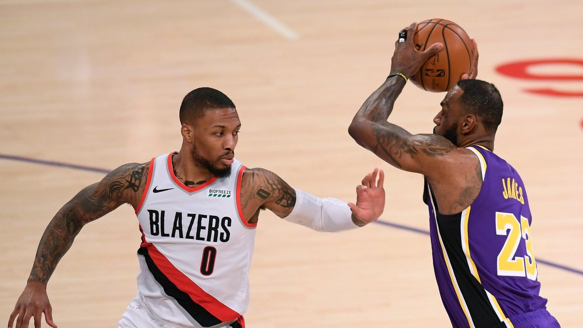 Halftime on ESPN:  @trailblazers 57 @Lakers 54  Dame: 24 PTS LeBron: 18 PTS, 3 BLK