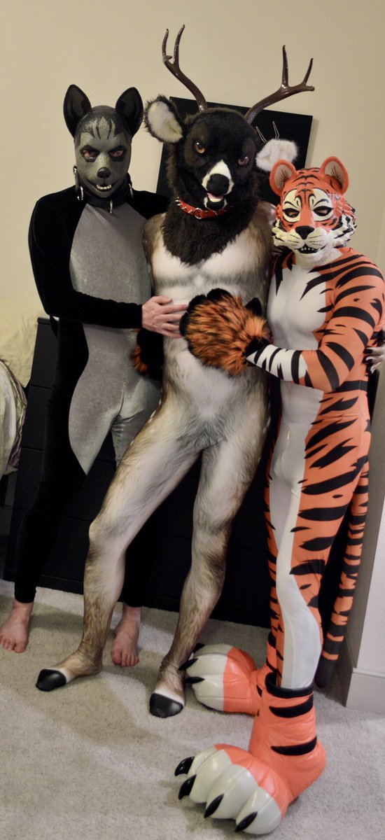 Photoshoot with @saigonthekomodo and @rubberdeer in our @PETSUITFORFUN petsuits for #FursuitFriday. The deer suit is new this week.