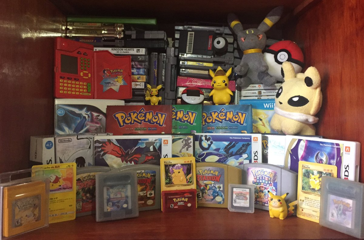 Missing a lot of merchandise (and I mean A LOT: a board game, music CD's, books, more figures, keychains, more cards and more plushies) but here's a photo to commemorate Pokémon Day.  Happy anniversary to one of my fav franchises! #PokemonDay #Pokemon25