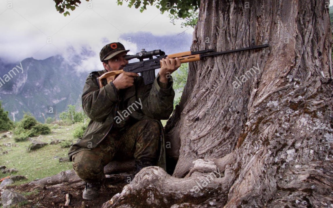 A KLA sniper in action in Kosovo,May 1999. Photograph by Trinity Mirror/Mirrorpix