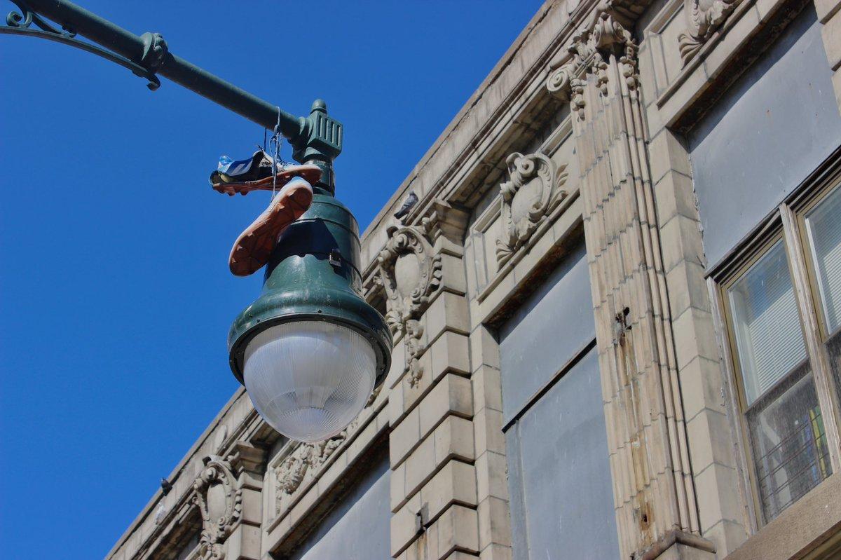 Hang up your #cleats #harlem .... 116th & Lenox .... #nyc   #gregoryeatonsphotography #letmeshootyou #letmeshootyou📸 #streetlight #photo #photooftheday #nycphotographer #nycphotography #harlemphotography #bluesky