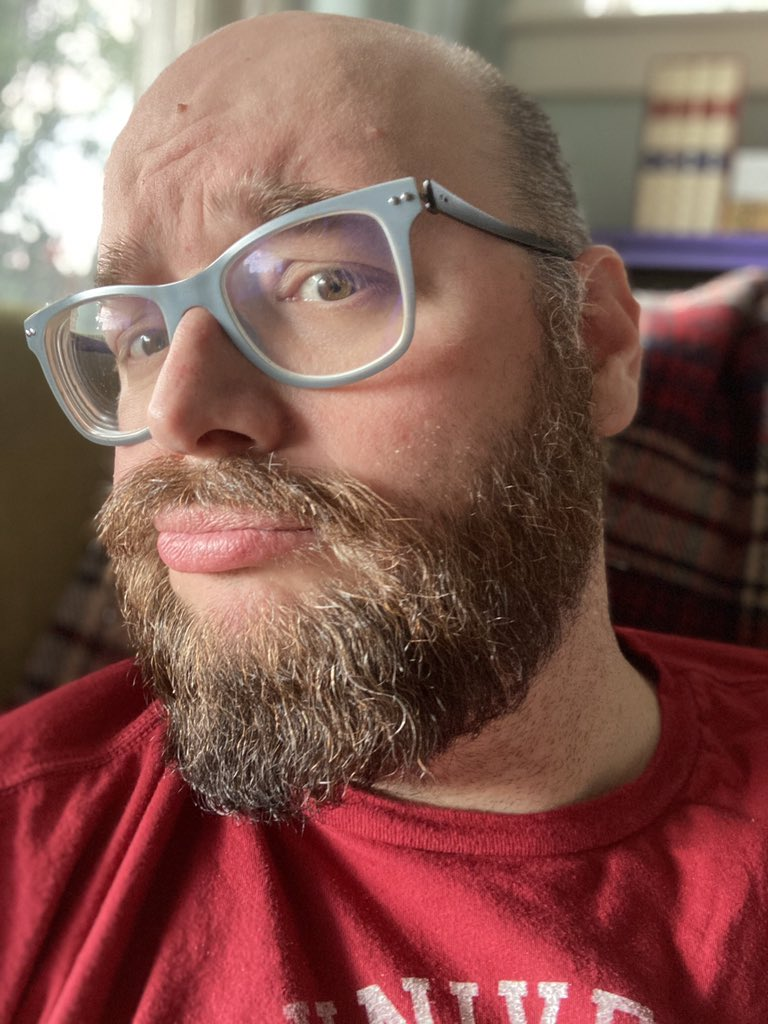 Discovered that you can hide your self-view on Zoom and still have your camera on.   I'm very excited to announce I will no longer be staring at myself incessantly and making these sorts of faces in response to my beard/glasses/face/life.  I swear, it wasn't you. It was me! https://t.co/mVFuqXmfj5