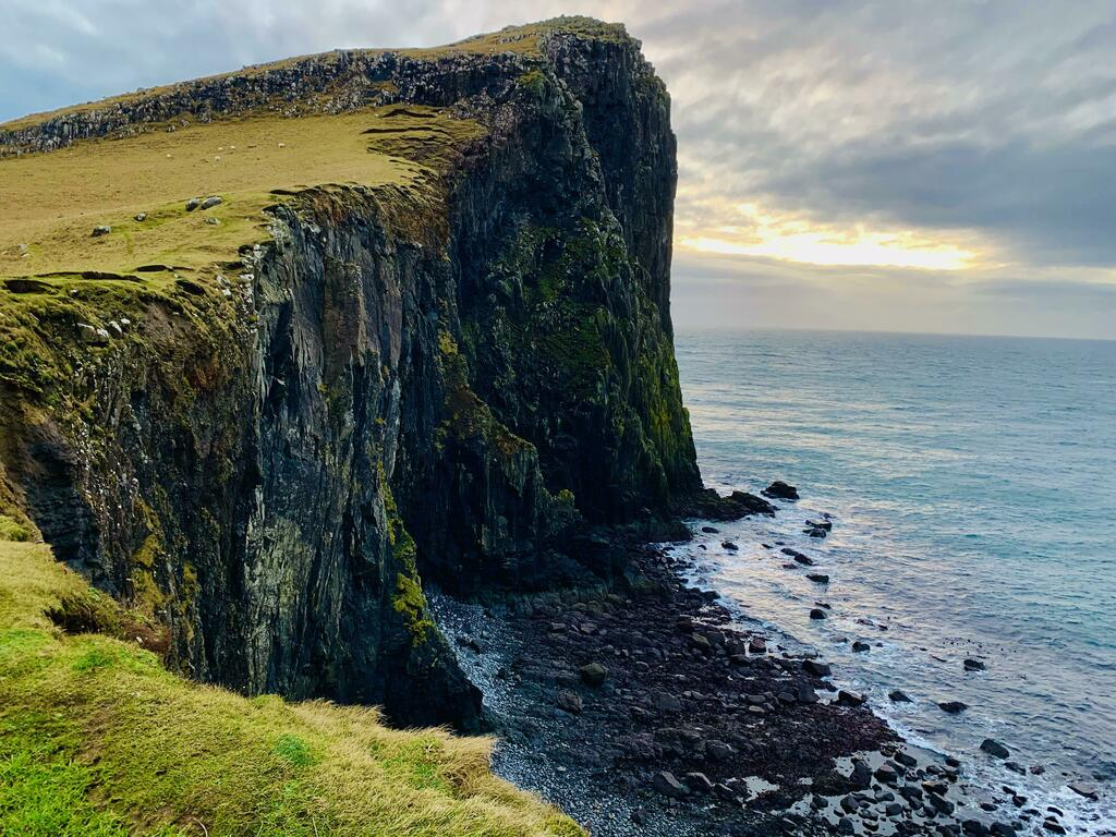 Sun setting at Neist Point cliff on the Isle of Skye, Scotland. [OC] [4032x3024] #nature #earth #photography #wanderlust Download our free photography eBook now: