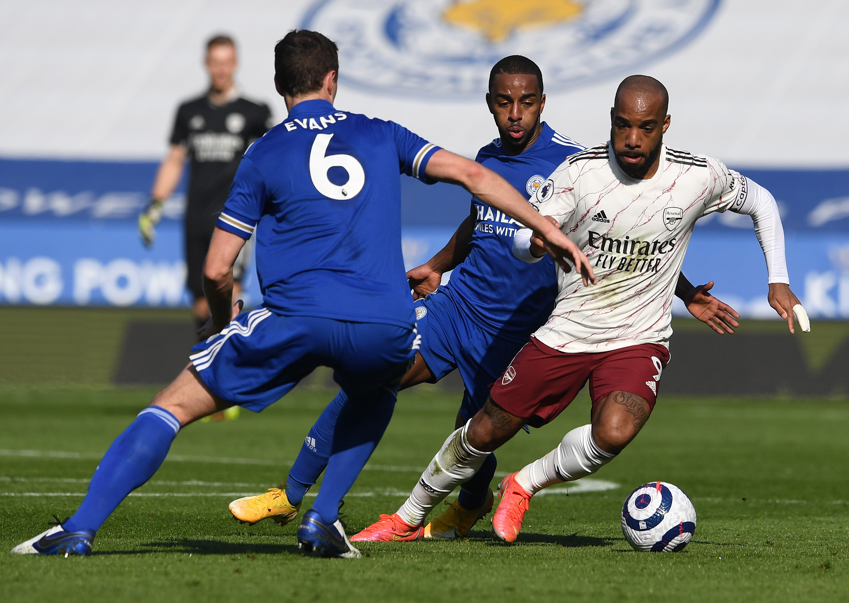 Alex Lacazette takes on two players