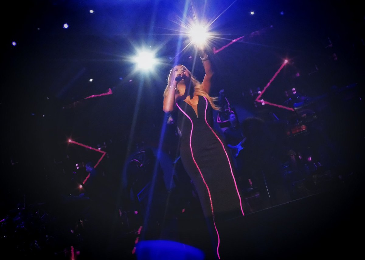 """Mariah Carey making us proceed with """"Caution"""" while on tour, is probably one of my most favorite photos I've taken, just because I'm also part of the #Lambily 🐏"""