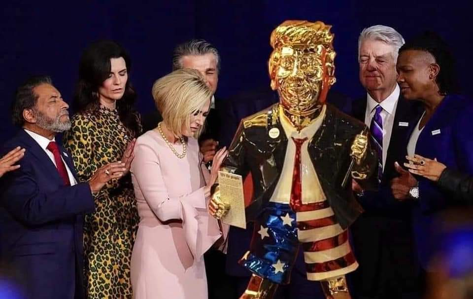 Holy sh!t!  Is this real?  They are PRAYING around the gold Trump statue?  That crazy Trump prayer woman? https://t.co/sP3Fray3Xd