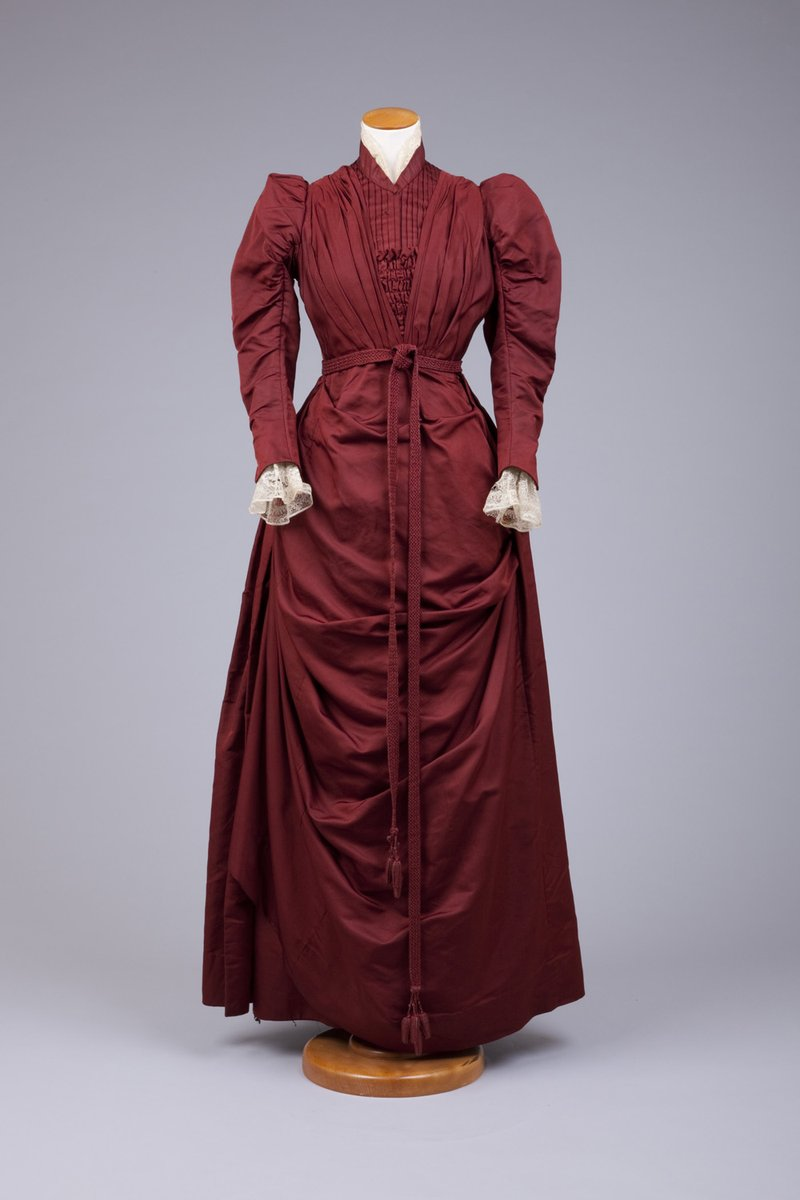 """Today's #ootd is this 1889-1892 deep red silk dress. @GoldsteinMuseum writes that the skirt has """"many deep folded pleats, but not a bustle, transition dress from 1880s."""" After that skirt decreased to make way for the S-curve silhouette. #FashionHistory"""