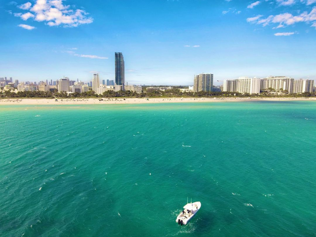 Here's a mathematical equation for you:  #Sun + #Ocean + #Beach = #MiamiBeach.  - 📷 unknown