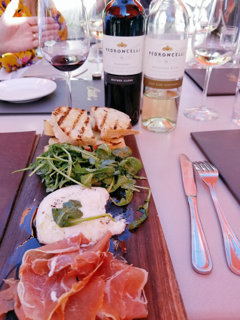 Dining outdoors in #Wine Country California, Geyserville ~ at Catelli's. Italian food that Stanley Tucci needs to try when he is in town!! Support local restaurants & eat out. Drink local too! We enjoyed @Pedroncelli lovely wines. #SonomaCounty #EatLocal #food #SearchingforItaly