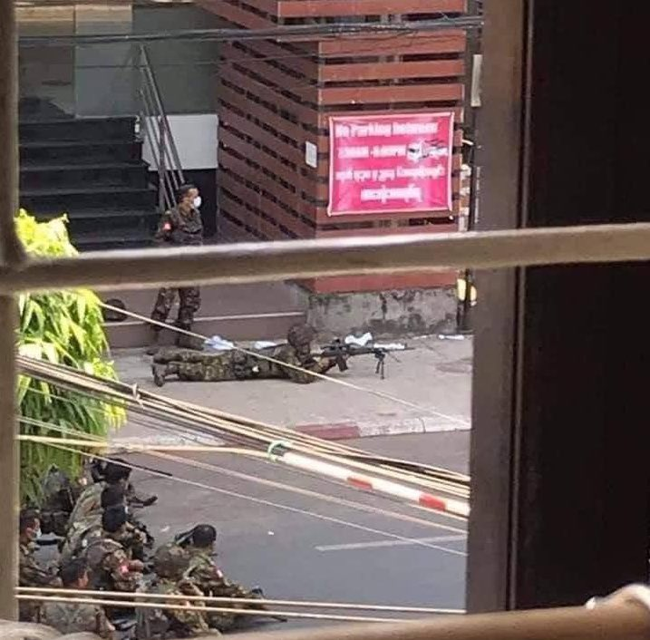 A soldier with a sniper rifle near an anti-coup protest in Sanchaung this afternoon in Yangon – social media photo