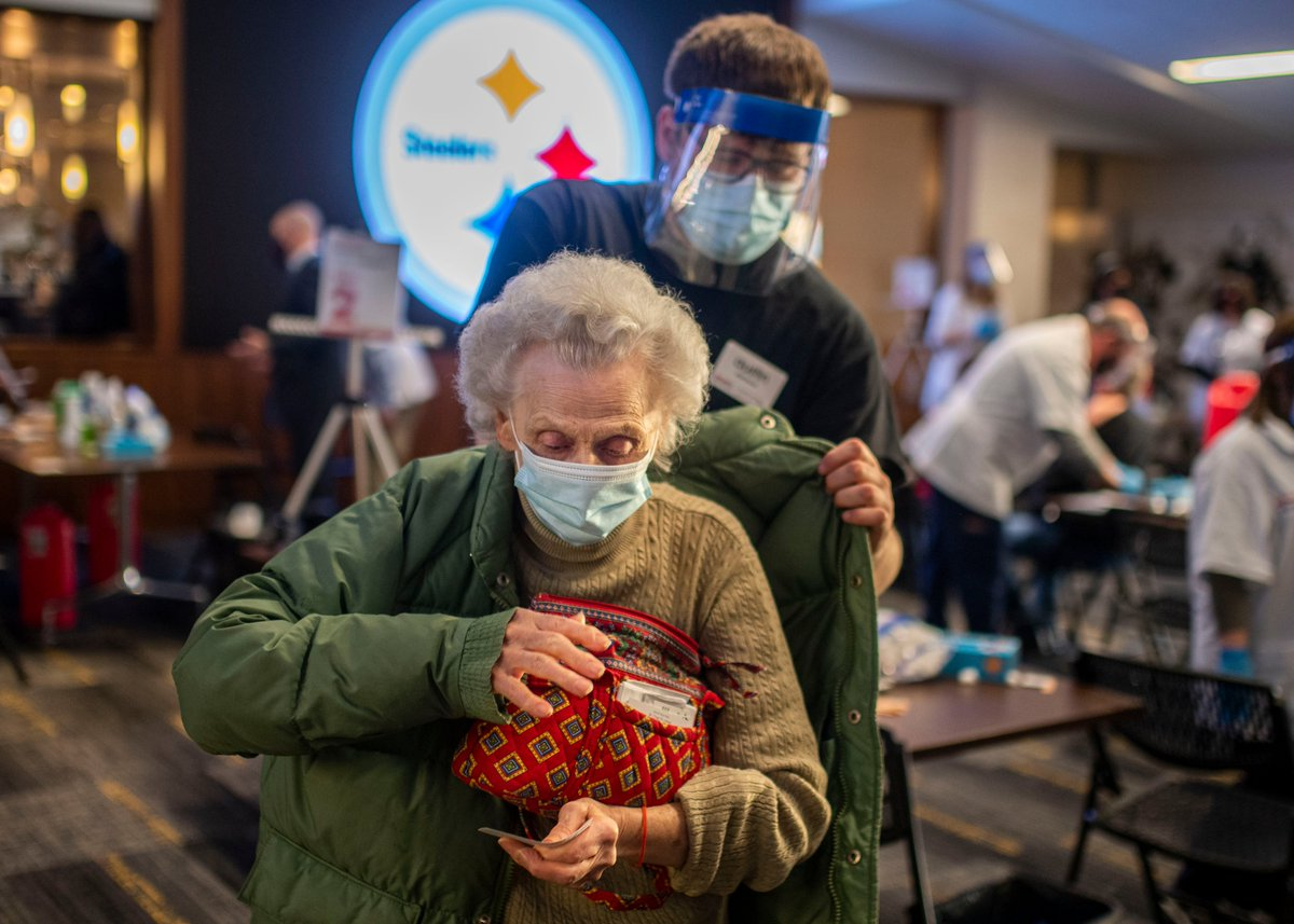 Pauline Napolitano, 92, of Monroeville, is helped with her coat after receiving a covid-19 vaccine during Giant Eagle's covid vaccination clinic at Heinz Field on March 2, 2021. @TribLIVE