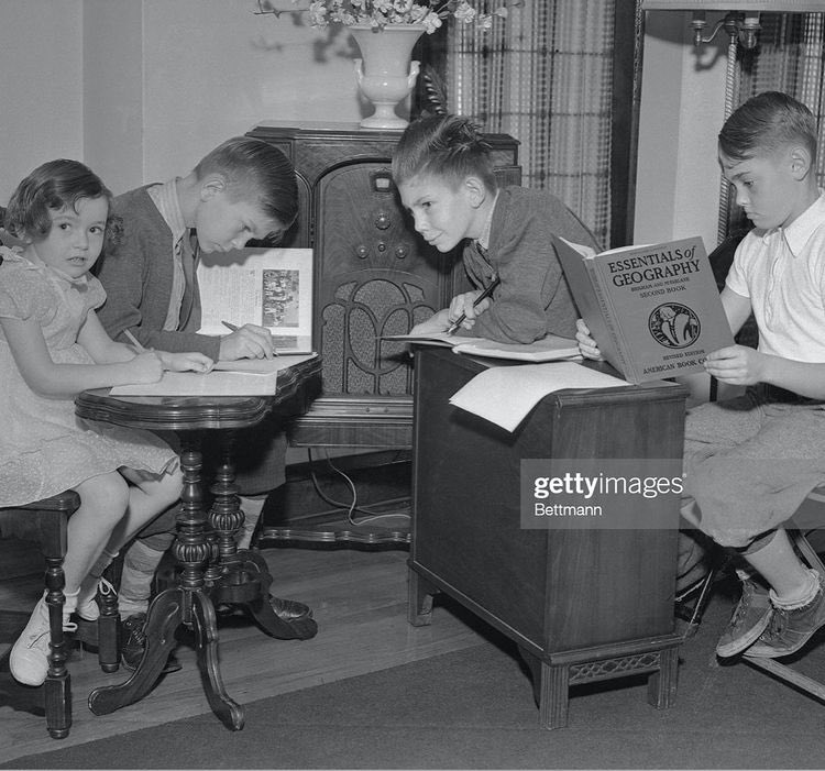 """Students listening to a teacher over the radio whilst """"online learning"""" during a polio epidemic in the 1930s.  That laggy Google Meet isn't that bad... https://t.co/hCqUz7LzlZ"""