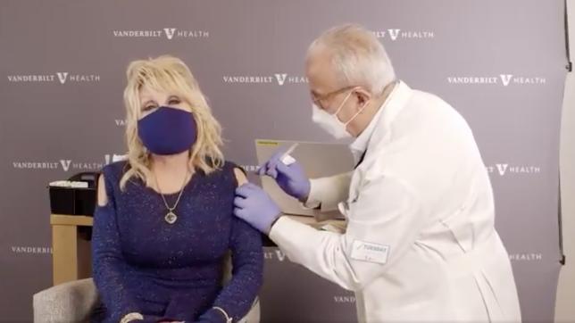 Watch Dolly Parton give her coronavirus vaccine shot a Jolene spin Photo