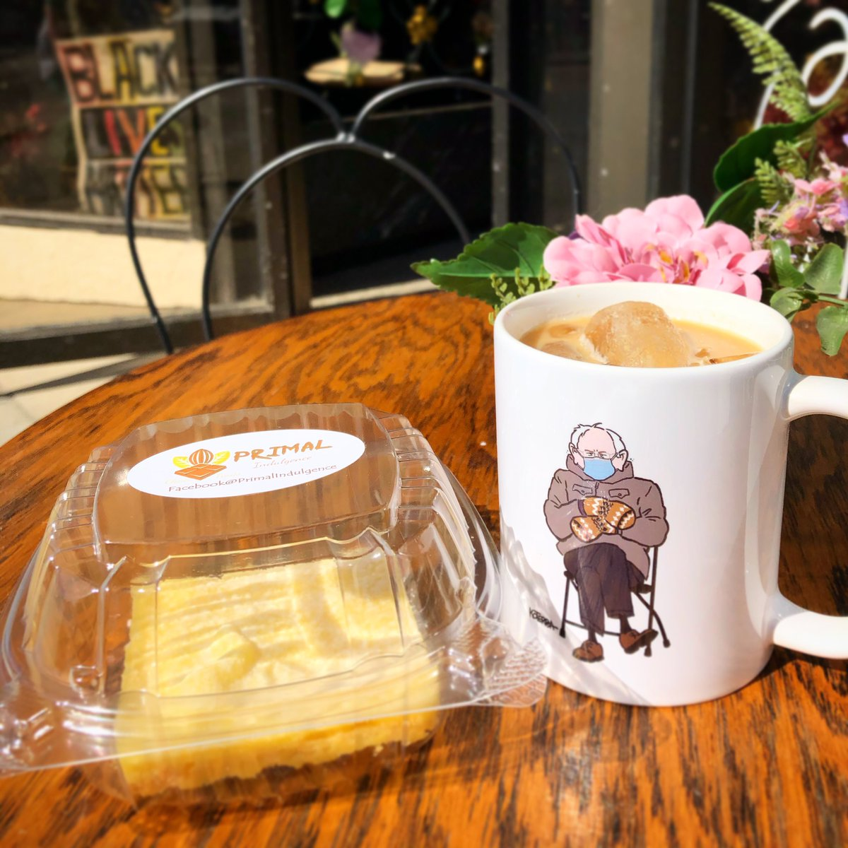 This iced vanilla latte goes PERFECTLY with keto lemon bars from @primalindulgence 😋 Now if only Bernie could warm up!  You can purchase your own Bernie mug created by @jeffreykoterba 💜   #omaha #berniesanders #berniesandersmemes #berniememes #berniemittens #cafe #latte #keto