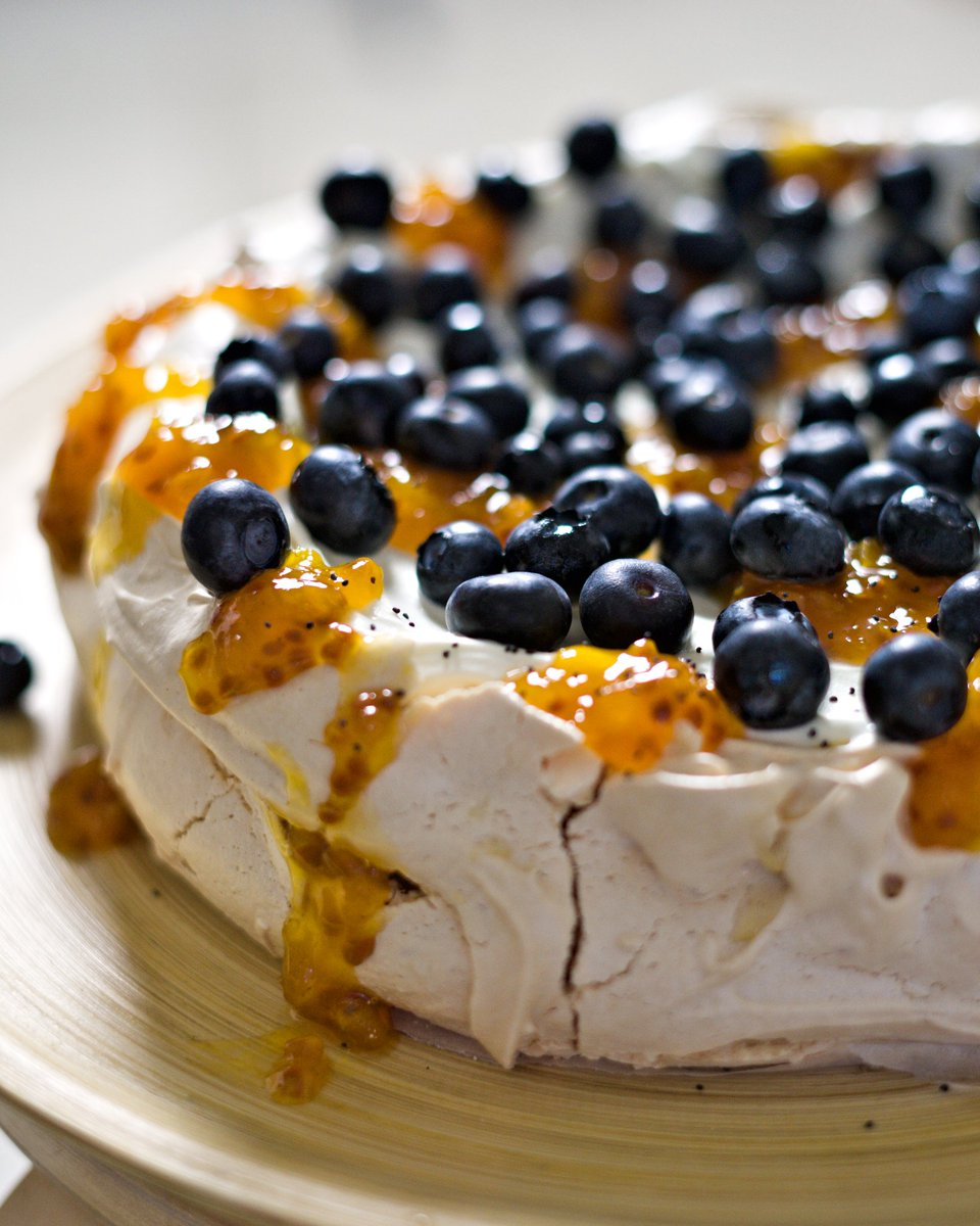 BLUE + CLOUDBERRY PAV #Homemade #cloudberry jam- caramelly berry jam is ultra #sweet. Poor baking skills/impatience caused the #meringue to crack. Filled with #vanilla #cream, and topped with tart #blueberries, #jam, and a pop of nuttiness from some poppy seeds. #pavlova #dessert