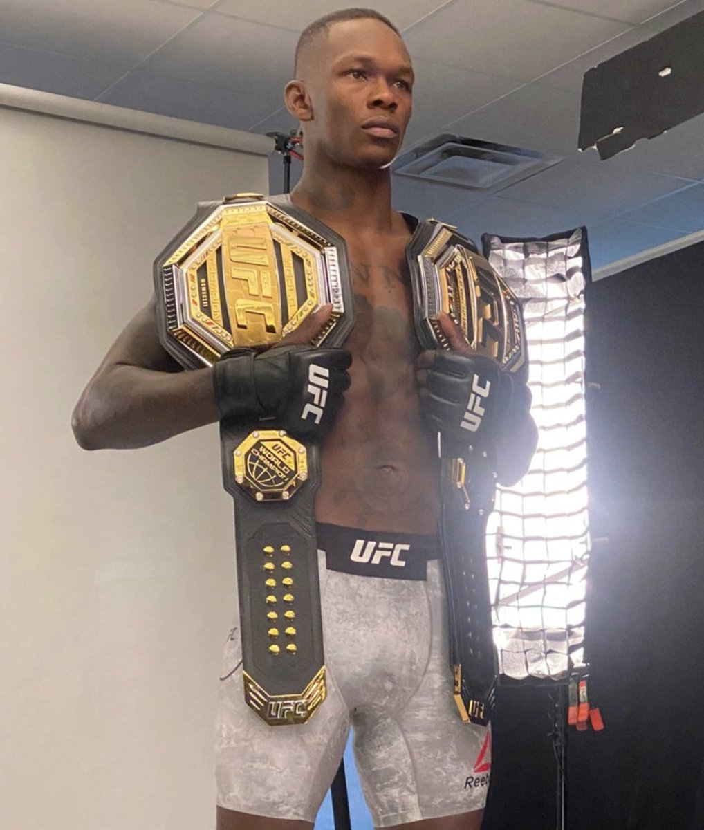An early look at Israel Adesanya with two UFC championship belts 🏆 🏆 #UFC259 (via IG/timsimpson)