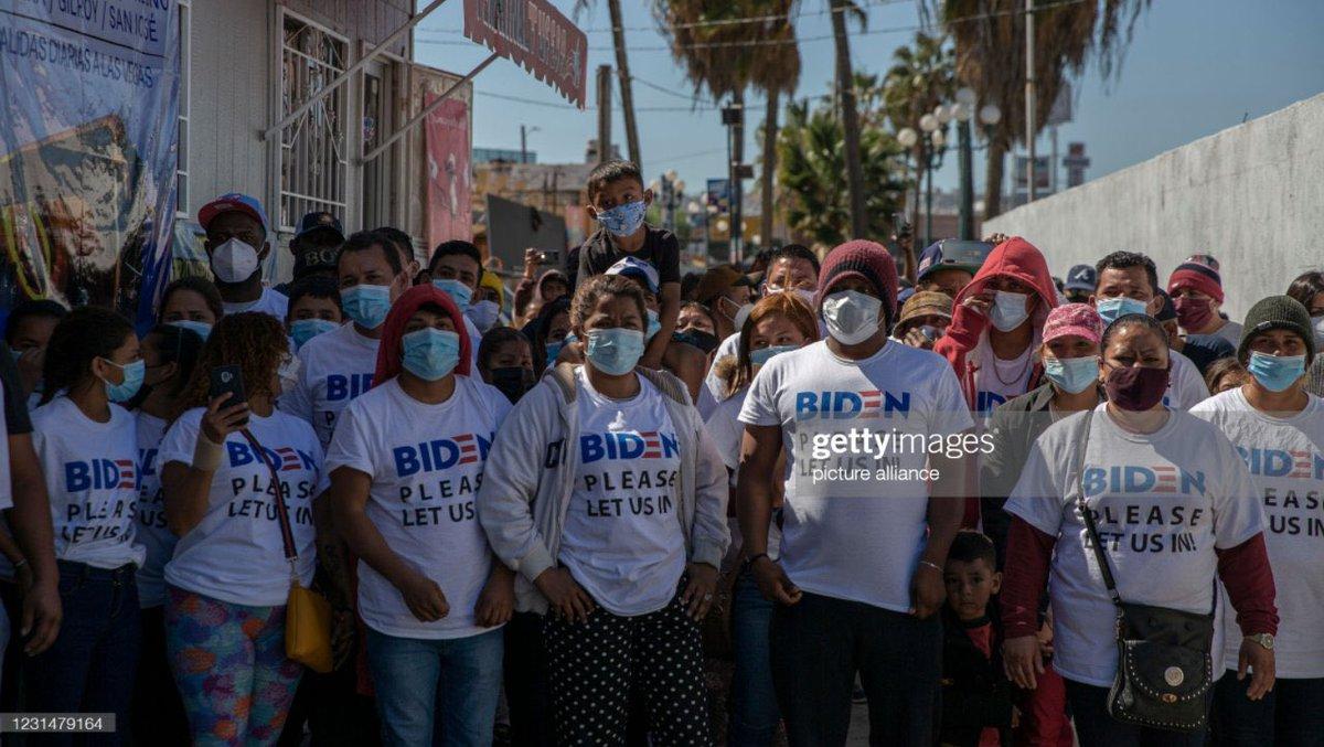 Migrants arrive at US-Mexico border wearing Biden shirts.