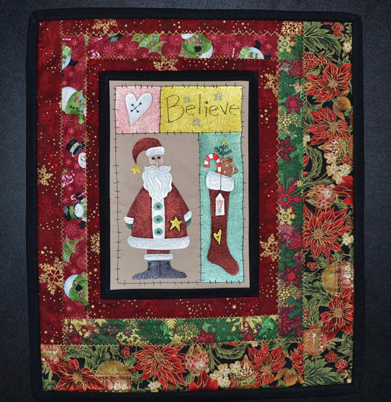 """""""Believe In Santa"""" Embroidered Quilted Wall Hanging/Table Topper  via @Etsy #quilt #santa #wallhanging #christmas #embroidery #tablerunner #stocking #tablecloth #homedecor #stars #poinsettia #snowman #ornaments #tree #gingerbread #candycane #heart #holiday"""