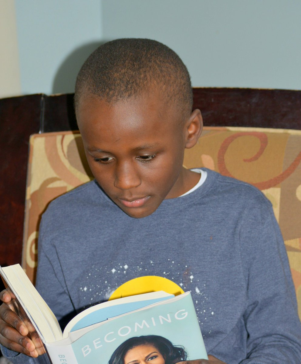 This is my nephew Brazil. He is eight years old and will be nine in November. He loves books!                      Brazil is reading 'Becoming' with his Great-Grandmother.  He told his Grandmother it is a nice book and that she should read it too! #Iambecoming