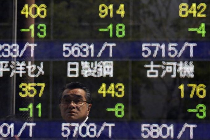 Asian Stocks Down as Powell Keeps Mum on Rising Inflation Rates Photo