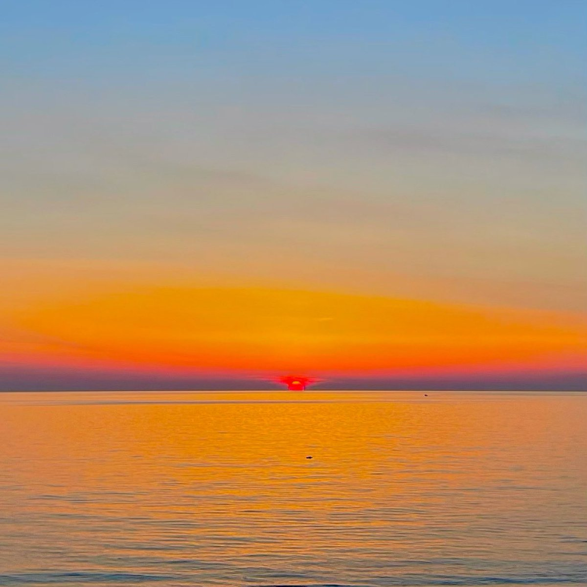 A red dot. A thin line.  #sunset #sun #photo #photography #sunsetphotography #sea #goldenhour #sky #colors #color #landscape #beauty #silence #picoftheday #peace #foto #tramonto #mare #pace #fotografia #italia #calabria #sud