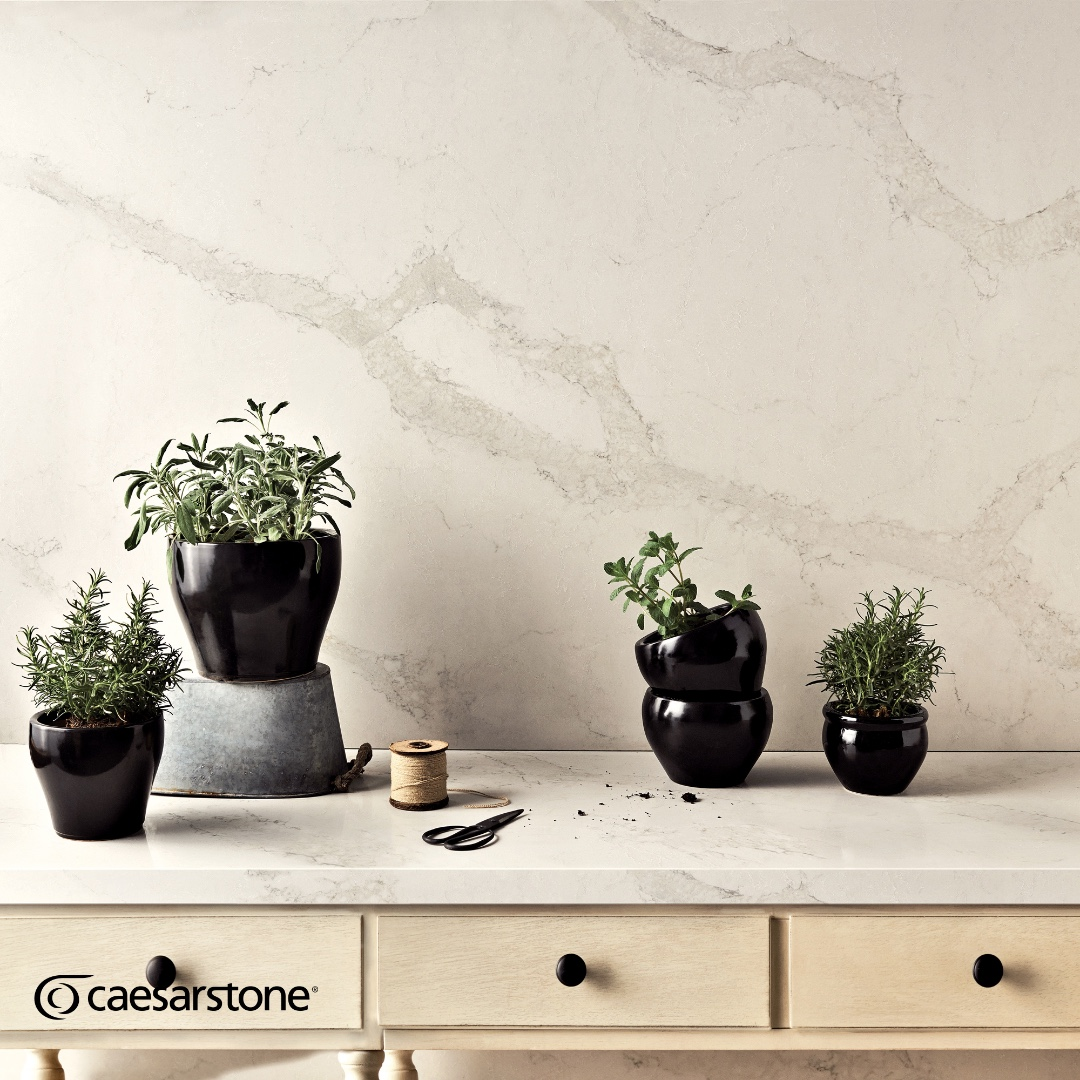 Large scale #splashbacks are not only very practical but can also help visually connect wall and base units. The timeless subtle veining of this Calacatta Nuvo #worksurface from @CaesarstoneUK adds warmth, interest and bucket loads of style. 🌐 spacesbydesign.co.uk