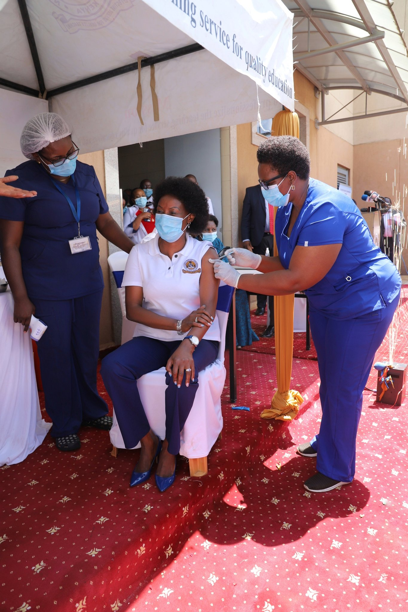 Dr. Macharia receives her Covid 19 jab. She has urged all teachers to follow suit and get vaccinated against the killer disease.