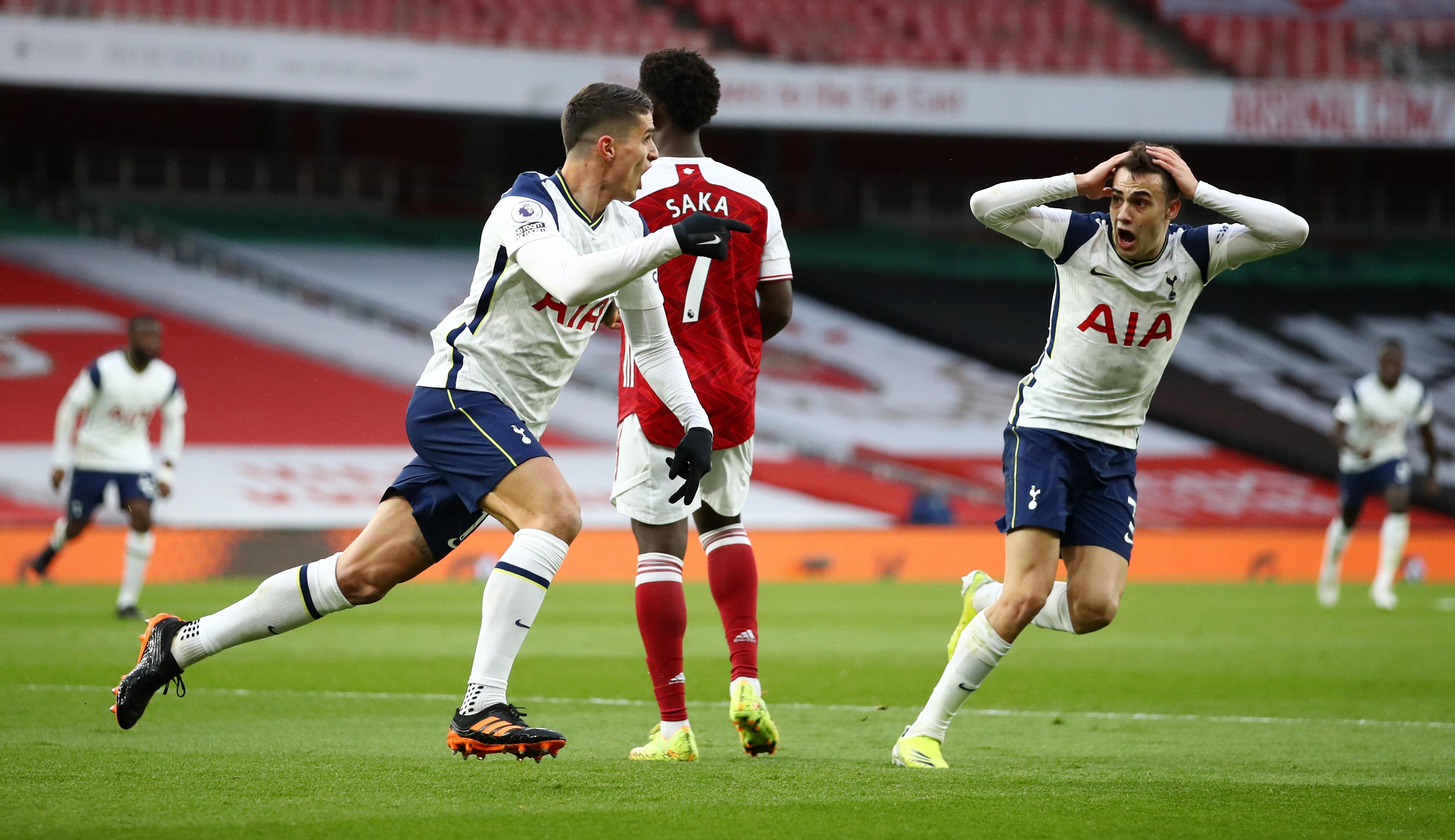 Sergio Reguilon reacts as Erik Lamela wheels away to celebrate his rabona kick goal against Arsenal. (Tottenham Hotspur website/Twitter)