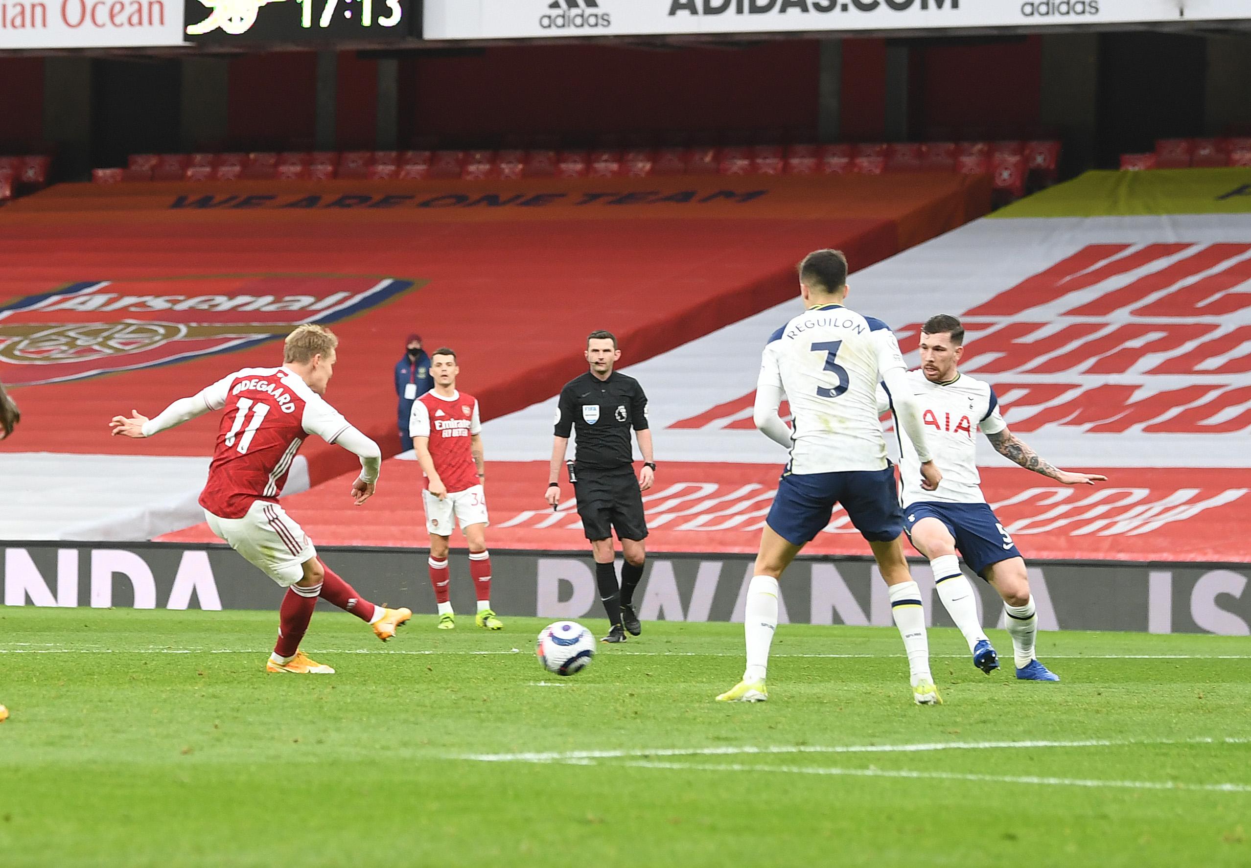 Martin Odegaard scoring in the north London derby