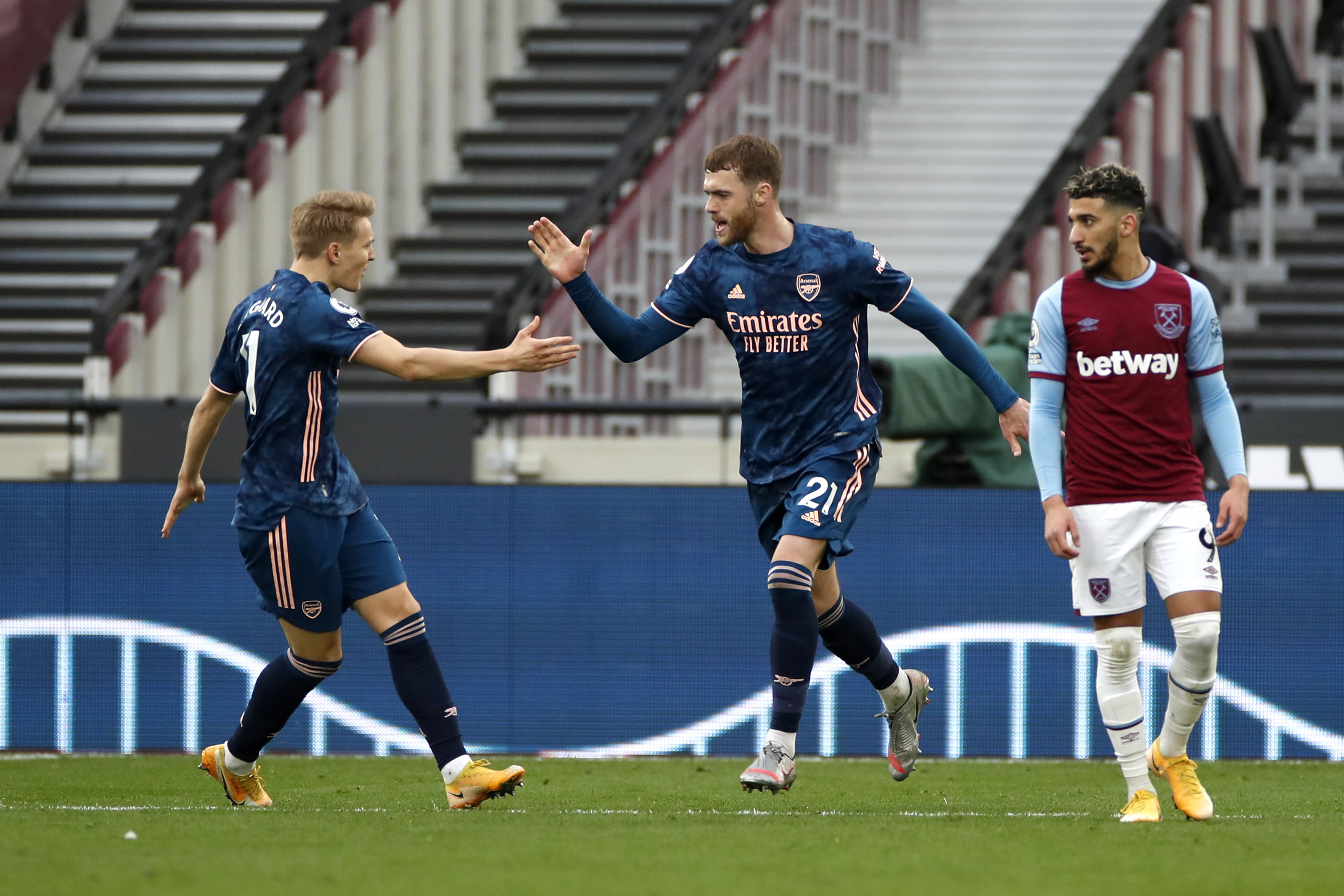 Calum Chambers high fives Martin Odegaard after our second goal