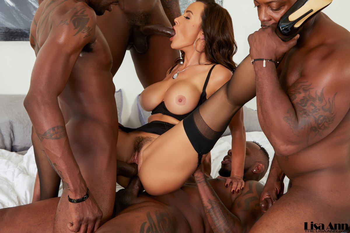 Lisa ann is getting gangbanged by a group of black guys, instead of going to work