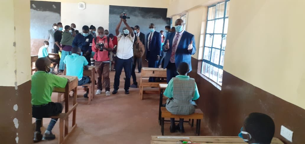 Basic Education PS Julius Jwan (Standing, right) monitors the start of the Math exam paper at Kisii Central  Primary school on Day One of the 2020 KCPE exams.