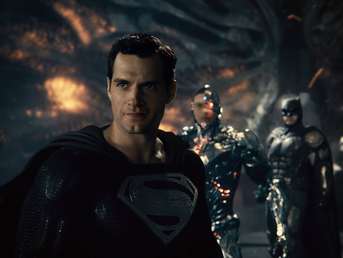 """Superman (Henry Cavill) left, Cyborg (Ray Fisher) middle, and Batman (Ben Affleck) right in """"Zack Snyder's Justice League"""" (2021)"""