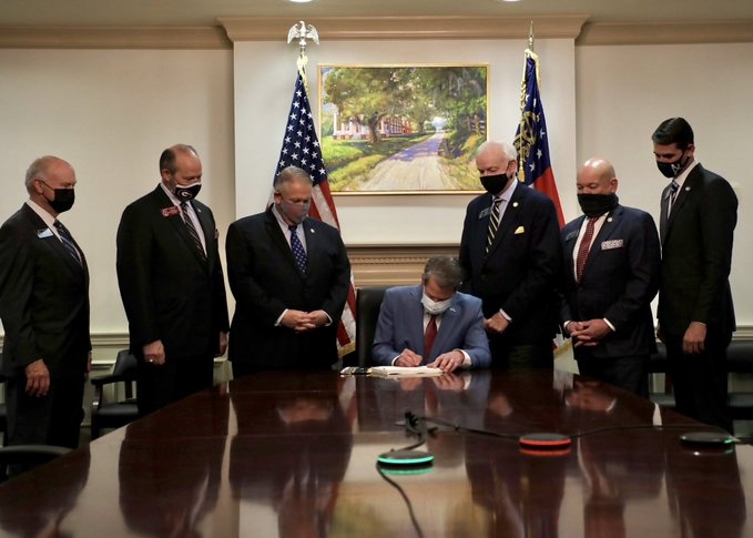 1. You've probably seen this picture of Georgia Gov. Brian Kemp and his gaggle of white men signing the state's voter suppression law -- the new, new Jim Crow. But there's a shocking angle to this story that you haven't heard. Sit down for this one... https://t.co/edHPmyeoiu